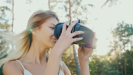 To-Plunge-Into-Virtual-Reality-A-Young-Woman-Puts-On-A-Helmet-Of-A-Virtual-Reality-In-The-Sun-The-Wi