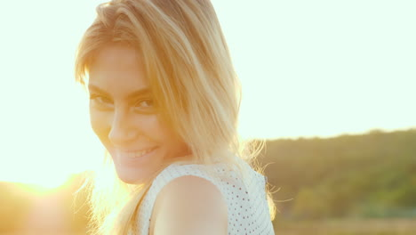 A-Young-Slim-Woman-In-A-Light-Skirt-Is-Spinning-In-A-Meadow-At-Sunset-Slow-Motion-4k-Video