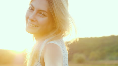 Portrait-Of-A-Beautiful-Young-Woman-At-Sunset-Orange-Light-Highlights-Her-Hair-Behind