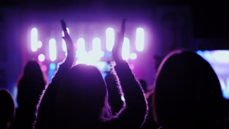 Spectators-Clap-Their-Hands-Keep-Their-Hands-Above-Their-Heads-Fans-At-A-Rock-Concert-In-The-Open-Ai