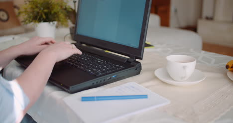 Home-Office-Concept-Woman-Typing-On-Laptop-Keyboard-