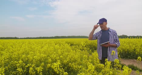 Farmer-Taking-Notes-At-Rapeseed-Field-1