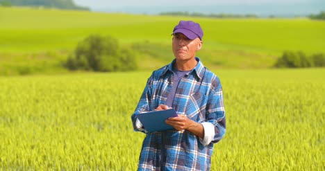 Male-Farmer-Analyzing-Wheat-While-Making-Report-2