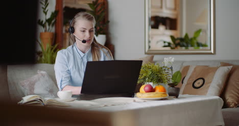 Video-Conference-On-Laptop-At-Home-Office-Businesswoman-Video-Chatting-With-Client