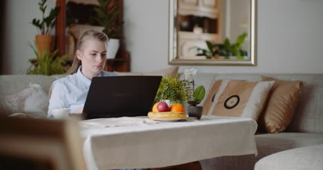Home-Office-Concept-Woman-Typing-On-Laptop-Keyboard-4