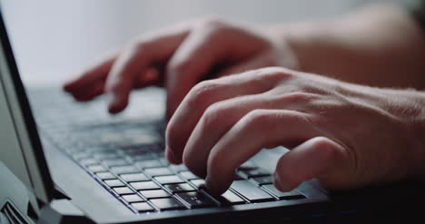 Business-Businessman-Hands-Type-On-Laptop-Computer-Close-Up-2