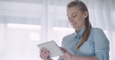 Home-Office-Woman-Working-On-Tablet-2
