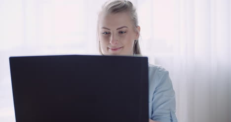 Smiling-Woman-Working-On-Laptop-At-Home-Office-Businesswoman-Typing-On-Computer-Keyboard-10