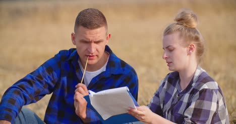Young-Farmers-Discussing-At-Wheat-Field-6