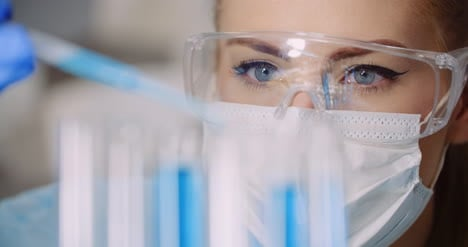Doctor-Carefully-Drips-Medicine-From-Pipette-Into-Sample-Glass-Tubes-For-Dna-Analysis-At-Laboratory-5