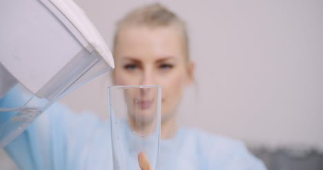 Extreme-Close-Up-Of-Female-Doctor-Drinking-Glass-Of-Water-3