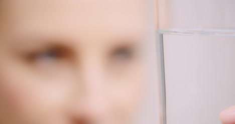 Extreme-Close-Up-Of-Woman-Looking-At-Glass-Of-Water