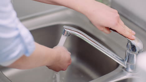Man-Washing-Hands-In-Sink-Covid-19