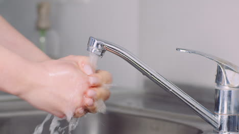 Man-Washing-Hands-In-Sink-Covid-19-1
