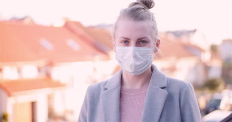 Woman-Put-Protective-Mask-On-Face