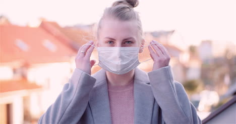 Woman-Put-Protective-Mask-On-Face-1