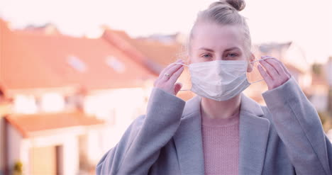 Woman-Put-Protective-Mask-On-Face-2