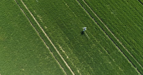 Agricultural-Researcher-Spraying-Filed-With-Herbicides-Or-Pesticides