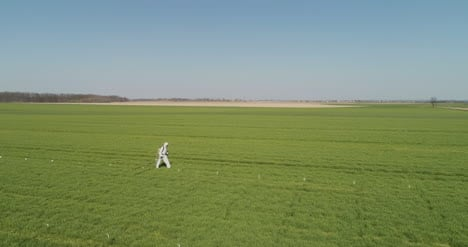 Agricultural-Researcher-Spraying-Filed-With-Herbicides-Or-Pesticides-2