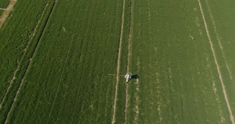 Agricultural-Researcher-Spraying-Filed-With-Herbicides-Or-Pesticides-7
