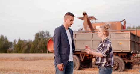 Young-Farmers-Discussing-At-Wheat-Field-7