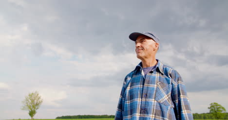 Farmer-Using-Digital-Tablet-At-Farm-Against-Blue-Sky-And-Clouds-4