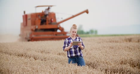 Agriculture-Female-Farmer-Walking-In-Wheat-Field-With-Digital-Tablet-4