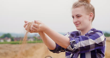 Young-Female-Farmer-Examining-Wheat-Grains