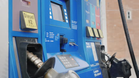 Woman-Pays-For-Refueling-A-Car-With-A-Credit-Card-In-A-Column-At-A-Gas-Station