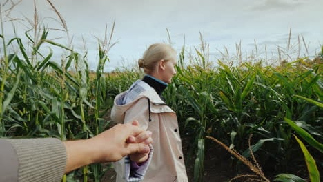A-Young-Woman-Farmer-Invites-You-To-Visit-The-Corn-Maze-By-Following-The-Hand-Behind-Her