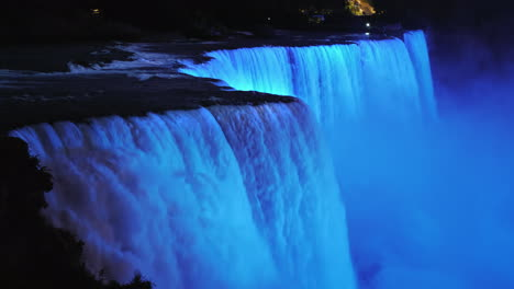 The-Colorful-Niagara-Falls-At-Dusk-Brightly-Illuminated-By-Spotlights-4k-Video
