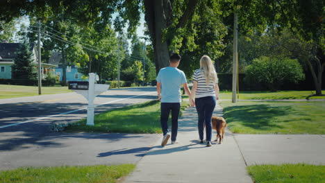 Young-Multiethnic-Couple-Walking-Down-The-Street-With-A-Dog