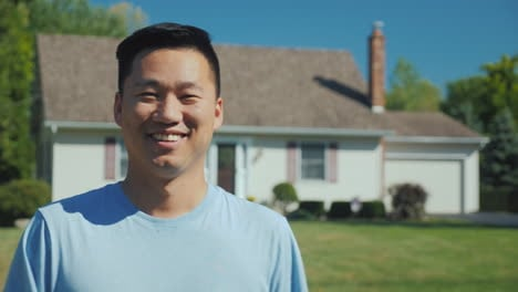 Portrait-Of-A-Happy-Asian-Man-On-The-Background-Of-A-New-Home-Looking-At-The-Camera-Smiling-Successf