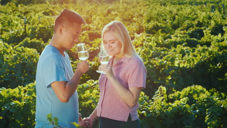 Young-Multi-Ethnic-Couple-Tasting-Red-Wine-At-The-Winery-Private-Tasting-And-Tourism-Concept