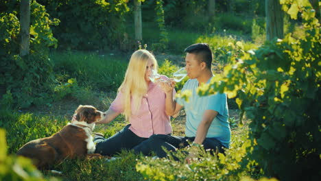 The-Family-Is-Resting-Near-His-Vineyard-With-A-Dog-Small-Farm-And-Rural-Business-Owners