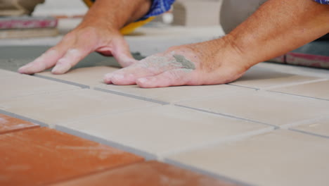 Workers-Laying-Tile-On-The-Floor-Close-