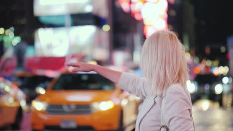 Woman-Stops-Famous-Yellow-Cab-In-Times-Square