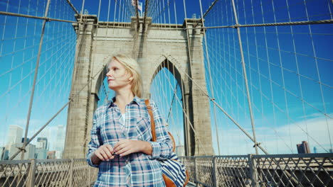 Woman-Tourist-Leisurely-Walking-Along-The-Brooklyn-Bridge-In-New-York-Usa-Travel