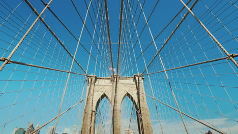 Walk-On-The-Brooklyn-Bridge-Pylons-And-Ropes-Of-The-Bridge-Against-The-Serene-Blue-Sky