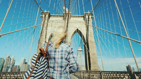 A-Woman-Takes-Pictures-Of-Herself-On-The-Famous-Brooklyn-Bridge---One-Of-The-Main-Attractions-Of-New