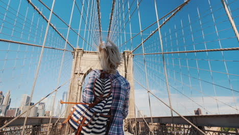 A-Serene-Woman-Fun-Runs-Through-The-Brooklyn-Bridge-Rejoices-In-Her-Trip-To-New-York
