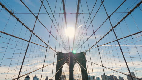 Walk-Along-The-Brooklyn-Bridge-From-Manhattan-To-Brooklyn-The-Sun-At-Its-Zenith-Shines-In-Frame-Pov-