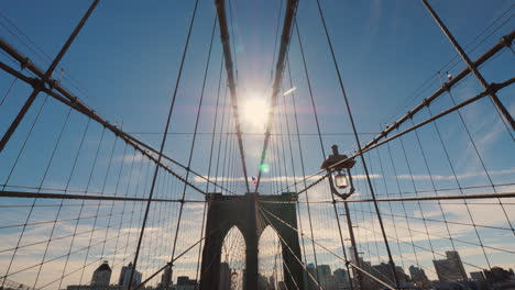 The-Sun-Shines-On-The-Elegant-Brooklyn-Bridge-In-New-York-One-Of-The-Recognizable-Symbols-Of-The-Cit