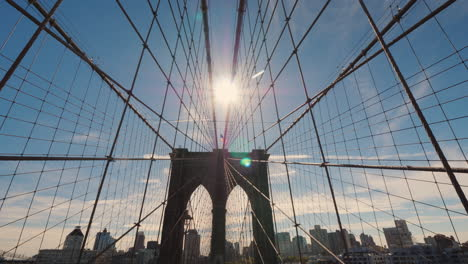 First-Person-View-Of-The-Brooklyn-Bridge-In-The-Direction-Of-Brooklyn-The-Sun-High-In-The-Sky-Will-L