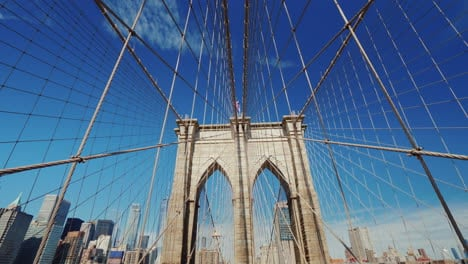 First-Person-View-Of-The-Brooklyn-Bridge-In-The-Direction-Of-Manhattan-Seen-Beautiful-Pillars-Of-The