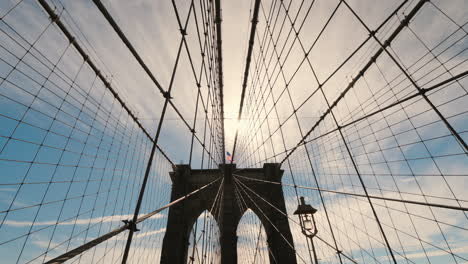 The-Silhouette-Of-The-Pylons-Of-The-Brooklyn-Bridge-A-Lot-Of-Ropes-Hold-The-Canvas-Of-The-Bridge