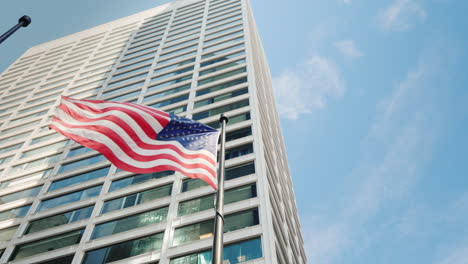 American-Flag-On-The-Background-Of-The-Office-Building