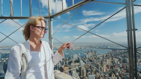 Portrait-Of-A-Young-Woman-Admiring-A-Beautiful-View-Of-The-City-Of-New-York