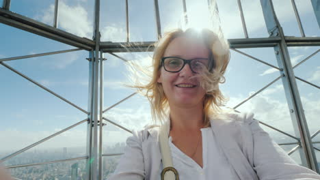 Portrait-Of-A-Happy-Woman-Shooting-Herself-On-Video-Against-The-Background-Of-The-City-Of-New-York