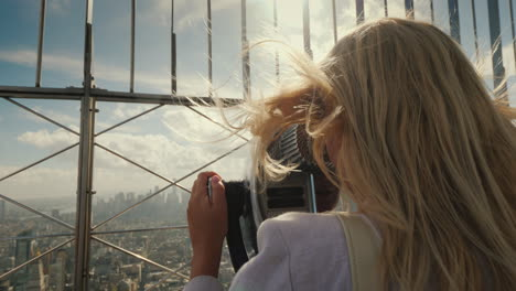 A-Woman-Looks-At-A-Beautiful-View-Of-New-York-From-The-Observation-Deck-The-Wind-Plays-With-Her-Hair